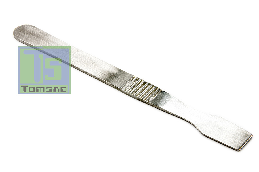 topnik - rozprowadzanie pasty za pomocą szpatułki